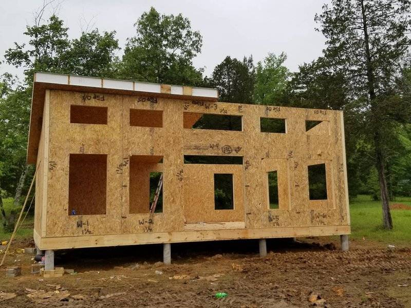 photo of a modern house kit on a pier and beam foundation