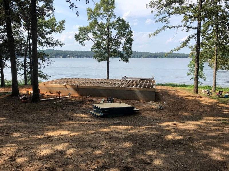 photo of a crawl space foundation in early stage construction on the shore of a lake