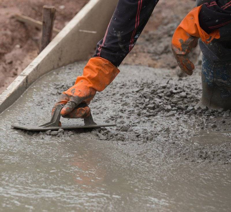 photo of someone smoothing a wet concrete slab foundation