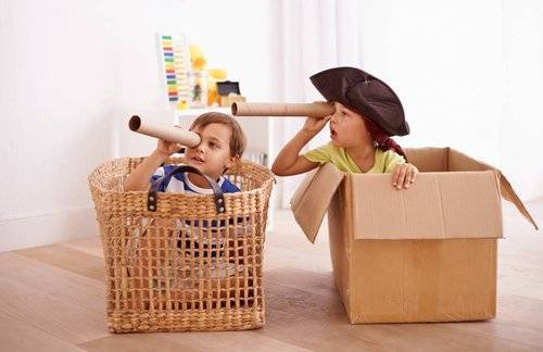 kids playing in boxes as pirates