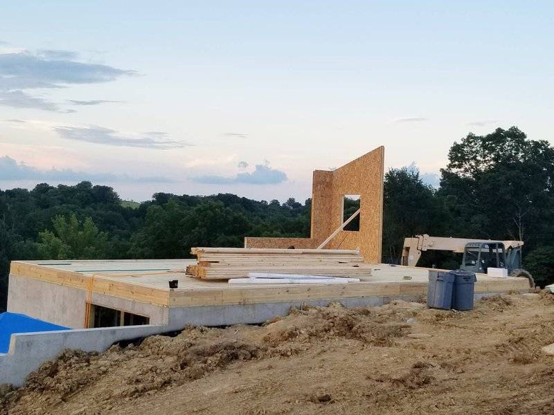 Kit Home Build Site with First Panels Up On Foundation
