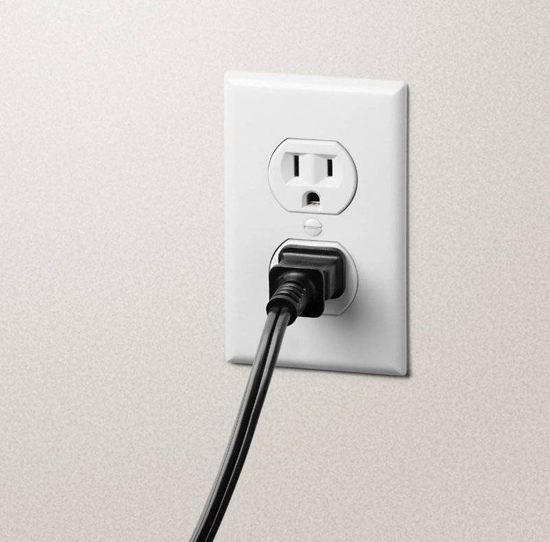 photo of an electrical outlet with appliance plugged in