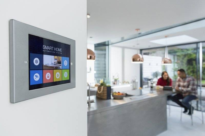 Photo of smart home touch screen on a kitchen wall